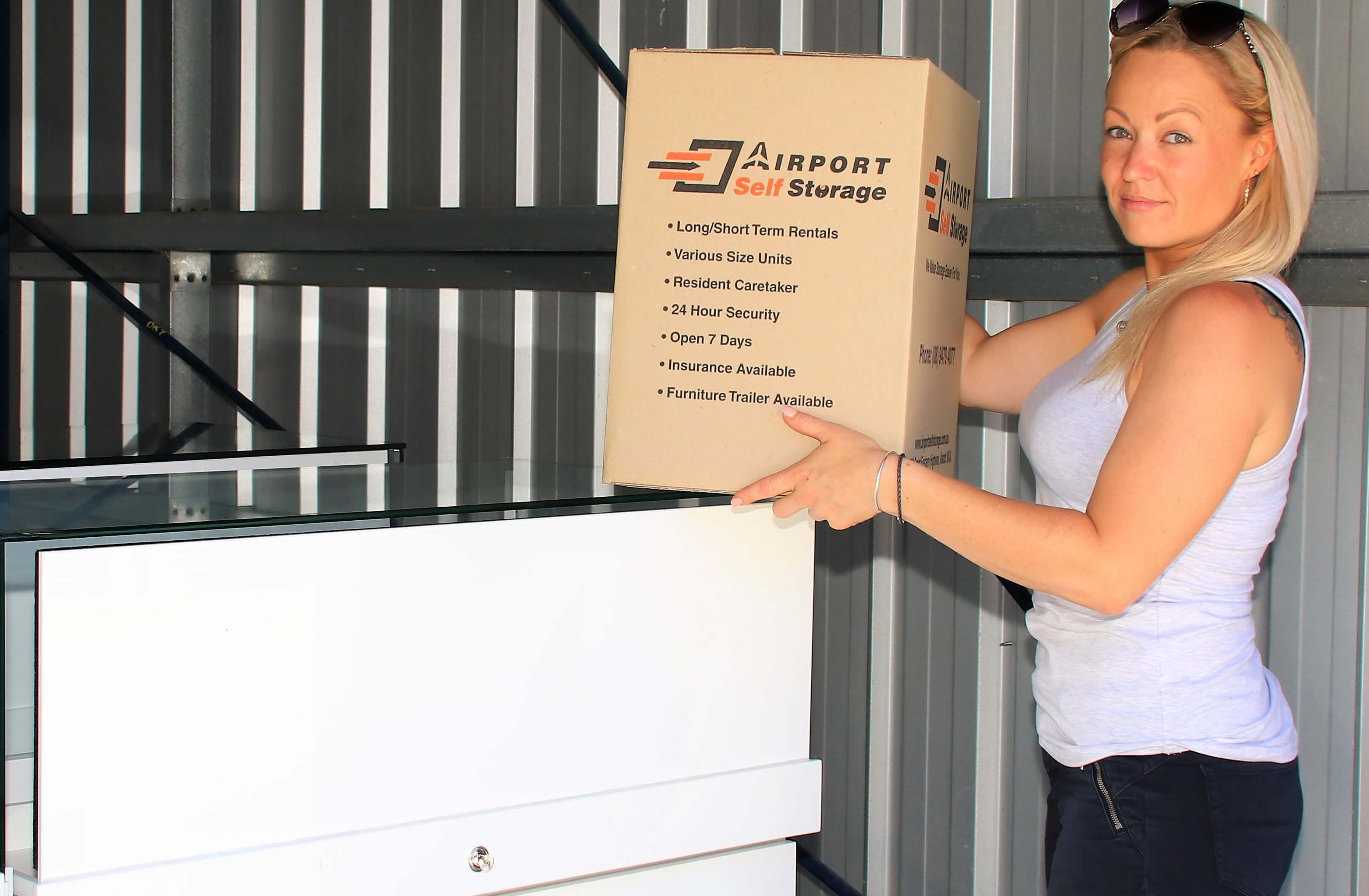 woman holding airport self storage box