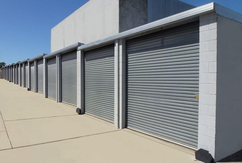 row of bark blue storage sheds